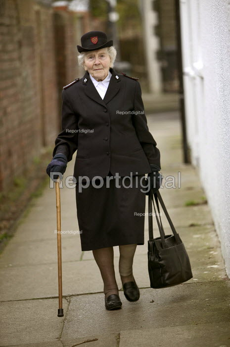 A 90 year woman who lives on her own in Bristol wearing her Salvation Army uniform. - Paul Box - 2004-03-20