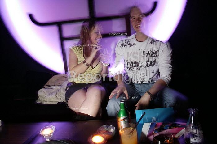 Women enjoy themselves at a bar in Bristol - Paul Box - 2004-04-05