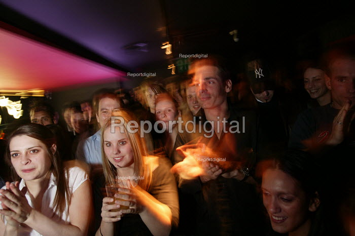 Nightclubbers watch a performer at a bar in Bristol - Paul Box - 2004-04-05