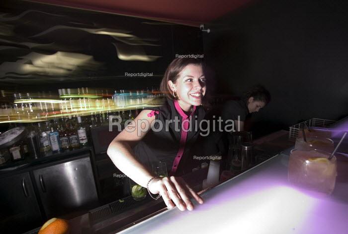 A female bar worker at nightclub in Bristol - Paul Box - 2004-04-05