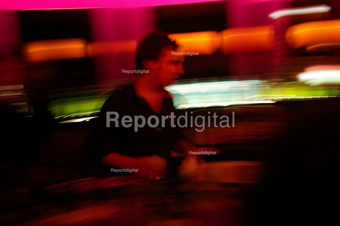 A male bar worker at nightclub in Bristol - Paul Box - 2004-04-05