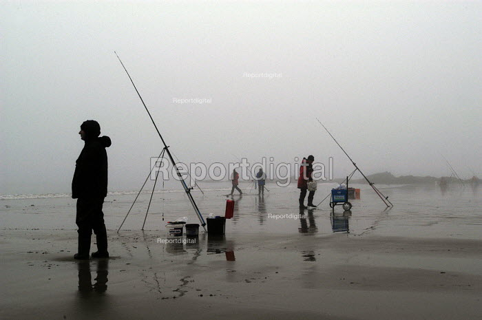 Fisherman on the beach at Saundersfoot on a misty day - Paul Box - 2004-01-10