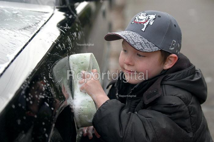 A boy washes a car - Paul Box - 2004-03-20
