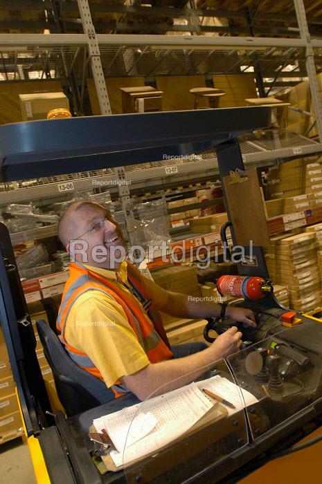 Ikea home furnishing store, palette truck picks flat pack items. - Paul Box - 2004-05-05