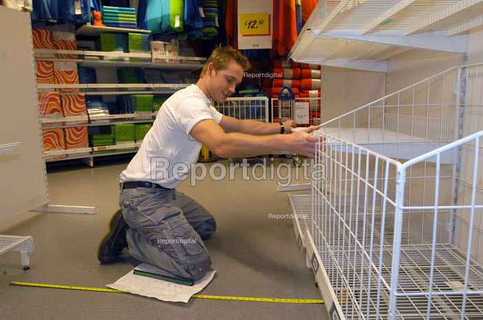 Ikea home furnishing store , an employee works putting... - Paul Box, PB405381.jpg
