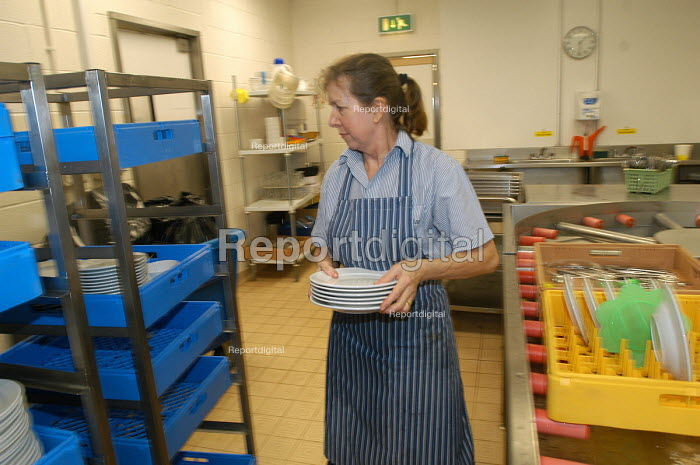 Ikea home furnishing store, an employee works in washing dishes - Paul Box - 2004-05-05