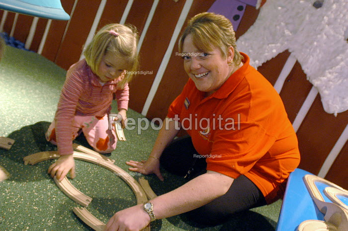 Ikea home furnishing store, a child plays in the instore creche with the creche worker - Paul Box - 2004-05-05
