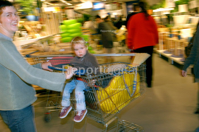 Ikea home furnishing store , customers shopping for home improvements , mother and child shopping. - Paul Box - 2004-05-05