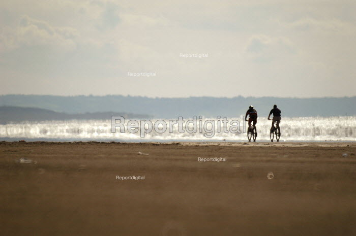 Cyclists on the beach at Pendine, Pembrokeshire. West Wales - Paul Box - 2003-08-20