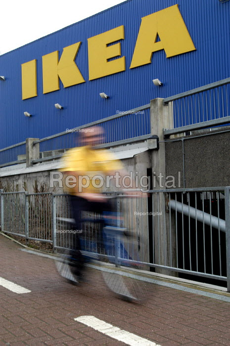 Ikea home furnishing store, a worker uses the company bicycle to get to work. - Paul Box - 2004-05-05