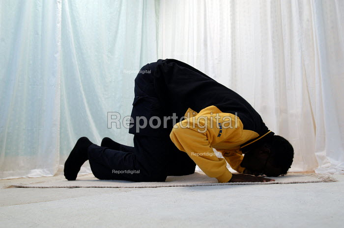 Ikea home furnishing store , a Muslim employee prays in the prayer room - Paul Box - 2004-05-05