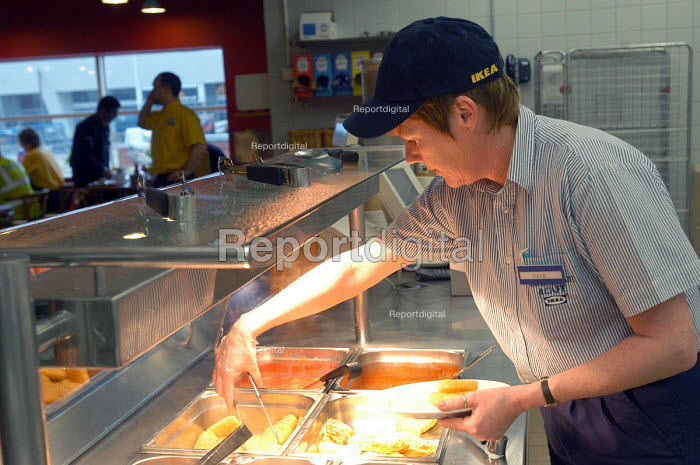 Ikea home furnishing store, an employee works on the food counter. - Paul Box - 2004-05-05