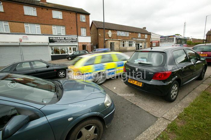 Police car speeding away, Lockleaze Bristol. - Paul Box - 2004-06-30