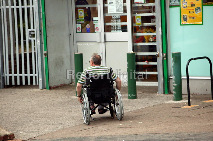 Disabled man in a wheelchair in the street, Bristol - Paul Box - 2004-06-30