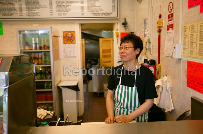 Shopworker at a Chinese takeaway Bristol - Paul Box - 2004-06-30