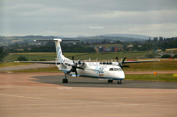 Exeter airport, aircraft taxiing along the runway. - Paul Box - 2004-06-10
