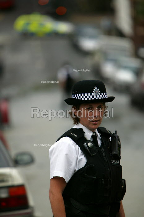 Police officer attends a bust water main in Bristol - Paul Box - 2004-06-10