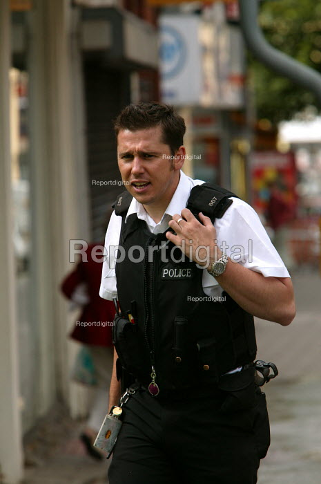 A police officer closes a road, as it flooded by a bust water main in Bristol - Paul Box - 2004-06-10
