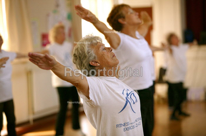 Elderly woman exercising at a keep fit class, Community Centre, Bristol. - Paul Box - 2004-06-02