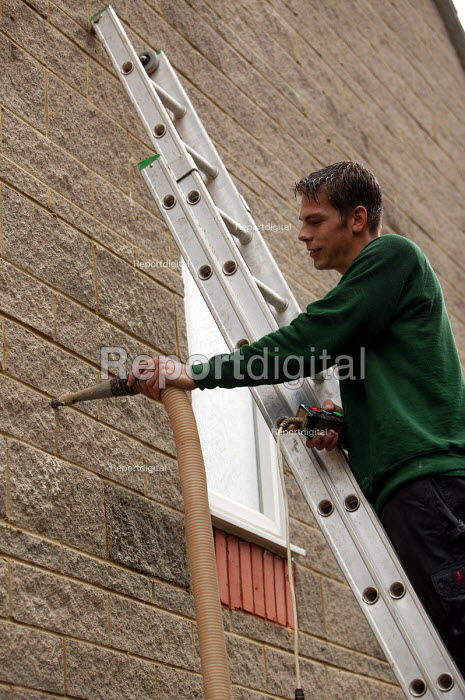 A home insulation company insulate a residential home. Shepton Mallett Somerset. - Paul Box - 2004-07-02