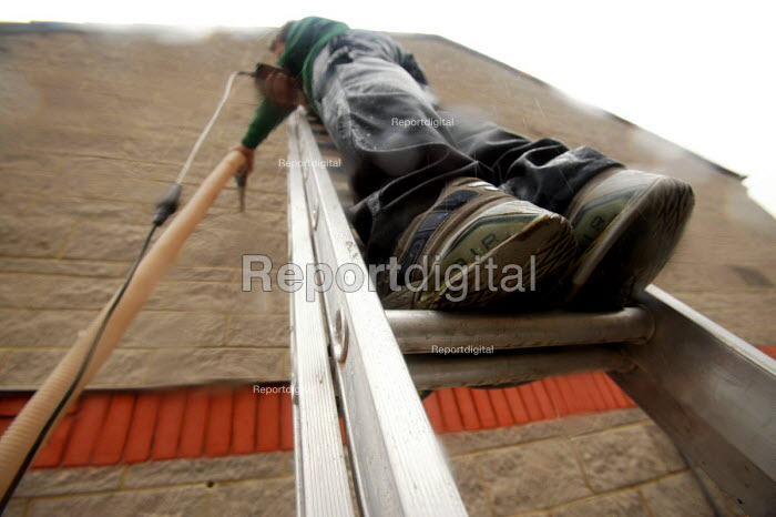 A home insulation company insulate a residential home. Shepton Mallett, Somerset - Paul Box - 2004-07-02