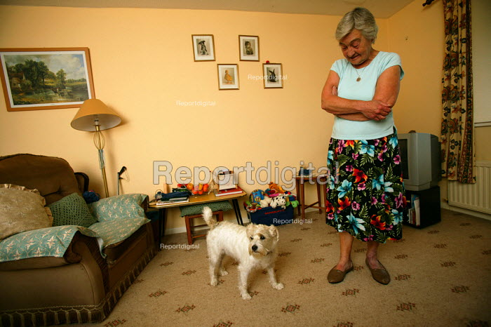 An elderly widow with her pet terrier dog. Shepton Mallett. Somerset. - Paul Box - 2004-07-02