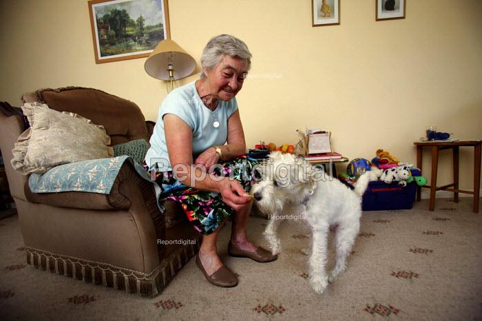 An elderly widow with her pet terrier dog. Shepton Mallett. Somerset. - Paul Box - 2004-07-02