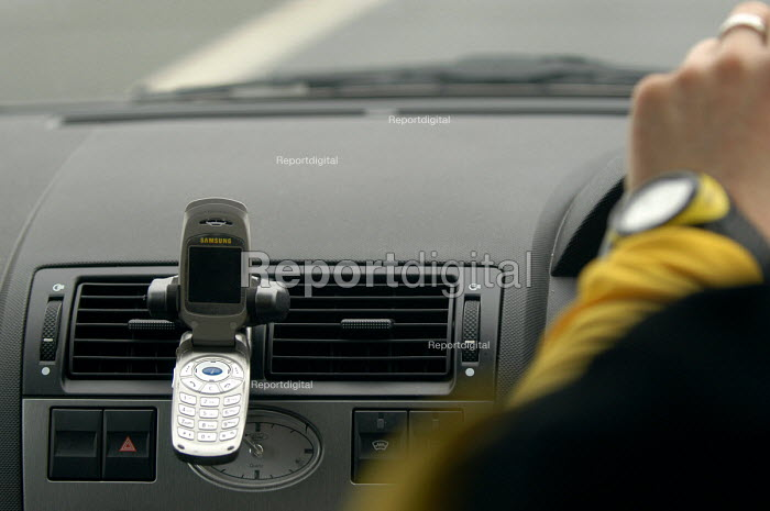 A car with hands free mobile phone holder. - Paul Box - 2004-07-02