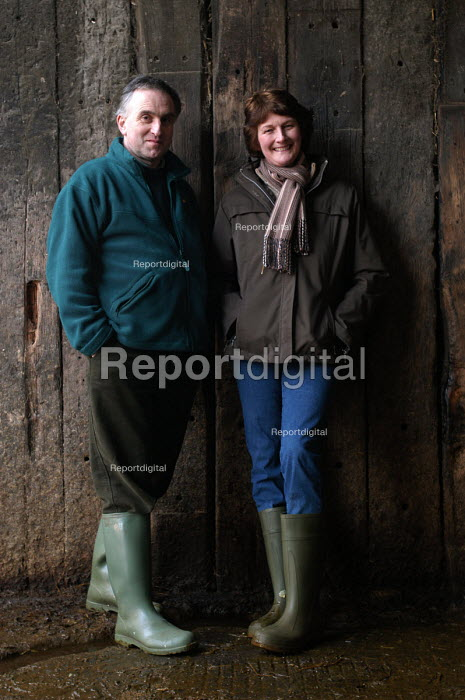 Defra organic farming scheme. A rented dairy farm in gloucestershire. The farmer and his wife - Paul Box - 2004-07-02