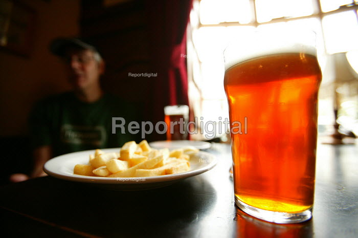 A pint of beer and pub food. - Paul Box - 2004-07-02