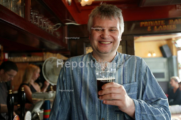A man drinks a pint of beer. - Paul Box - 2004-07-02