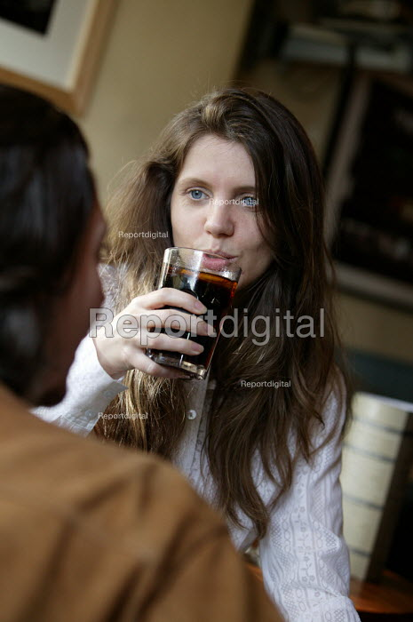 A woman drinking in a pub. - Paul Box - 2004-07-02