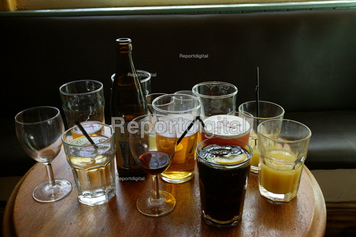 A table full of alcoholic drinks and half empty glasses. - Paul Box - 2004-07-02