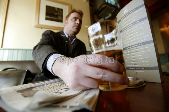 A man drinks a pint of beer in a bar in Bristol. - Paul Box - 2004-07-02