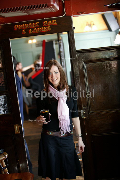 A woman drinking in a pub. - Paul Box - 2004-07-02