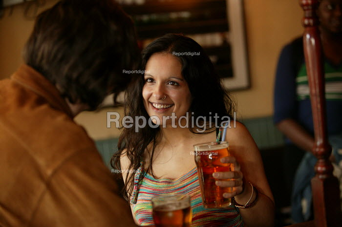 A woman drinks a pint of beer. - Paul Box - 2004-07-02