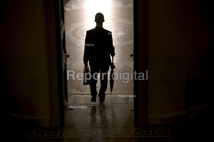 A business man arrives at a conference. - Paul Box - 2004-08-02