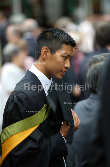 A chinese student at a graduation ceremony, Bath. - Paul Box - 2004-07-01