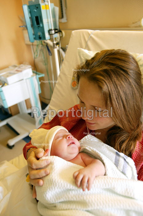 Mother just after she has given birth, with their newborn baby. - Paul Box - 2004-07-01