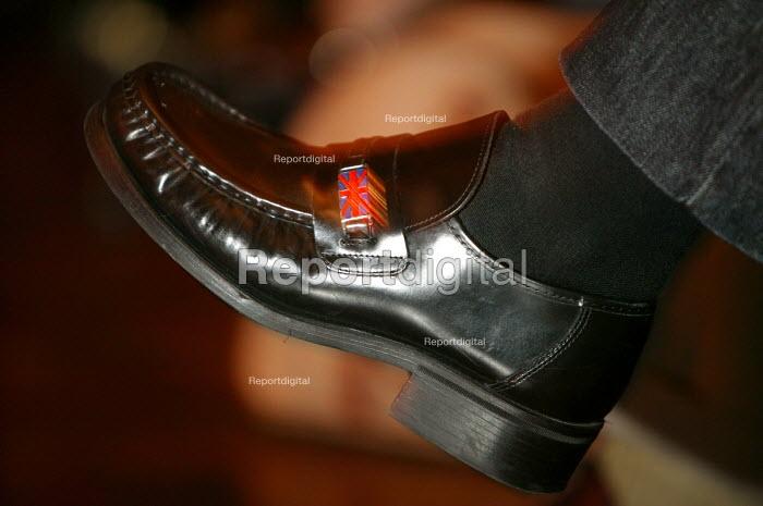 A Union Jack flag on a leather shoe, UKIP conference. The Colston Hall, Bristol. - Paul Box - 2004-10-02