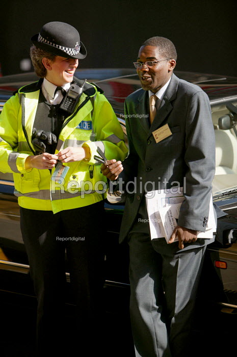 A police officer talks to Robert Kilroy Silk's chauffer UKIP conference. The Colston Hall, Bristol. - Paul Box - 2004-10-02