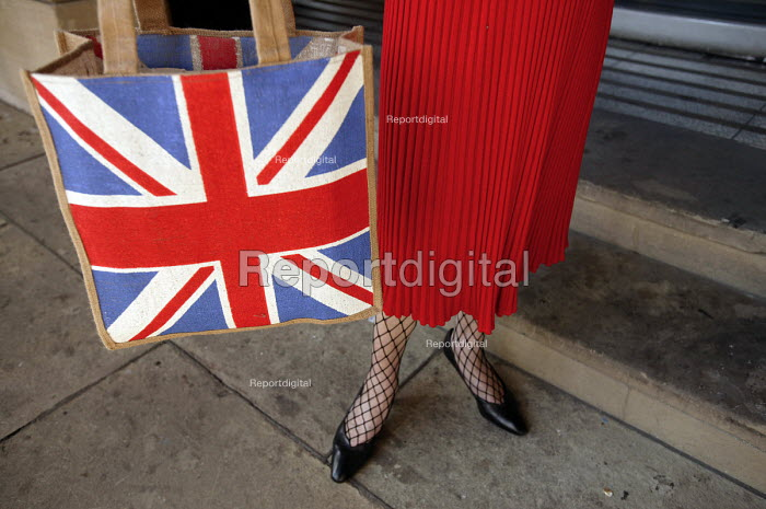 A UKIP supporter with Union Jack shopping bag. at the UKIP conference The Colston Hall, Bristol. - Paul Box - 2004-10-02