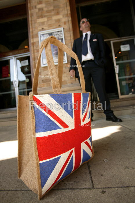 A UKIP supporter with Union Jack shopping bag at the UKIP conference The Colston Hall, Bristol. - Paul Box - 2004-10-02
