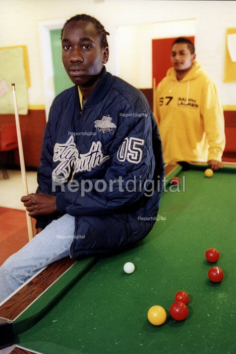 Teenager plays pool, at youth centre in Bristol - Paul Box - 2004-07-22