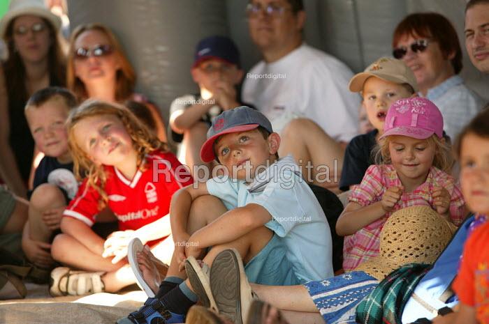 International kite festival, Bristol. Children listen to story telling. - Paul Box - 2004-09-05