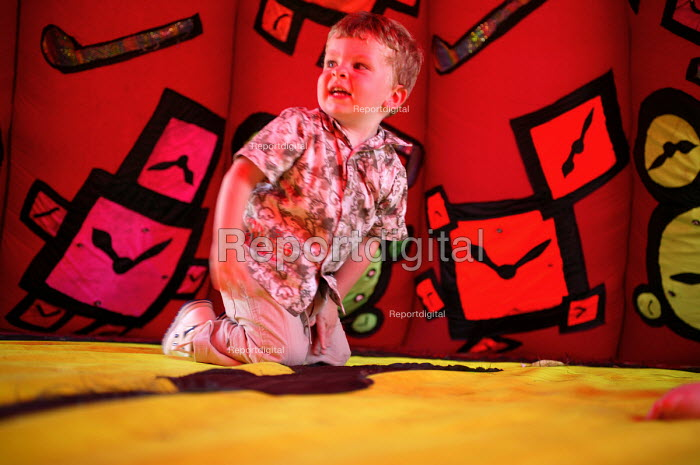 International kite festival, Bristol . A child inside an inflatable. - Paul Box - 2004-09-05