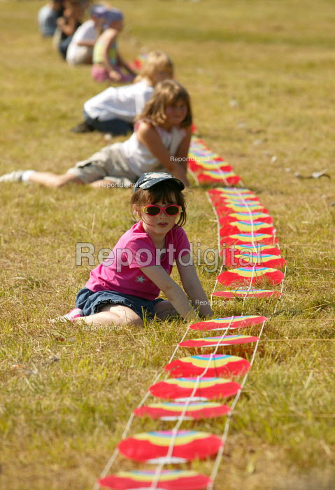 International kite festival, Bristol . Kids help with a dragon kite - Paul Box - 2004-09-05