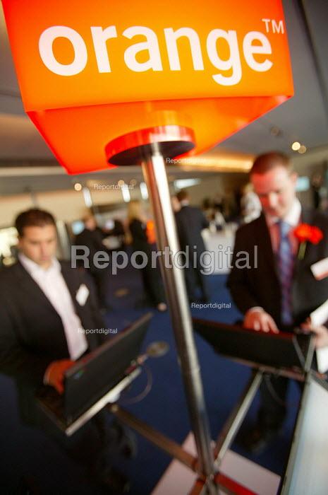 Orange 3G technology show Birmingham. Promoting the 3G network. Businessmen use wireless networking. - Paul Box - 2004-09-01