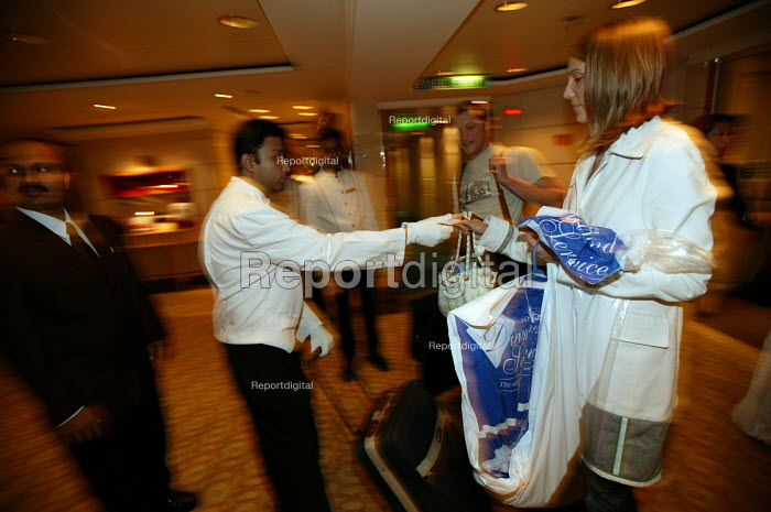 The Aurora cruise ship, a P&O cruise ship. Indonesian workers greet guests. - Paul Box - 2004-06-02