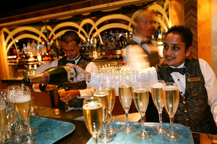 The Aurora cruise ship, a P&O cruise ship. Indonesian bar staff serve champagne. - Paul Box - 2004-06-02